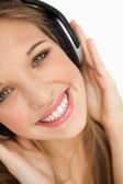 Close-up of a beauty listening to music — Stock Photo