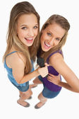 High-angle shot of two young beauty singing — Stock Photo