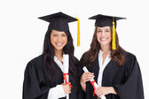 Two friends stand together after graduating — Stock Photo