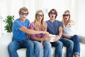 A group of friends watching a scary 3d movie — Stock Photo