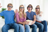 Friends shocked as they watch a scary 3d movie — Stock Photo