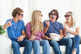 Friends laugh and joke around while watching a movie — Stock Photo