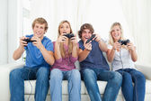 A group of friends playing video games together — Foto Stock