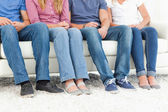 Half length shot of four pairs of feet — Stock Photo