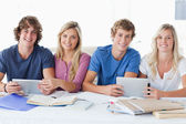 A smiling group of students looking at the camera — Stock Photo