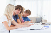 Students studying together at the table — Stock Photo