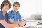 A pair of male students smiling as they both look at the camera — Stock Photo