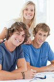 Three smiling students as they look at the camera — Stock Photo