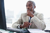 Serious entrepreneur while working with a computer — Stock Photo