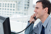 Smiling office worker on the phone — Stock Photo