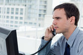 Serious office worker on the phone — Foto Stock