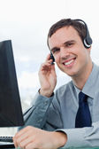 Portrait of an office worker using a headset — Stock Photo