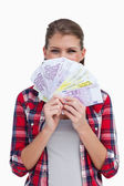 Portrait of a rich woman holding bank notes — Stock Photo