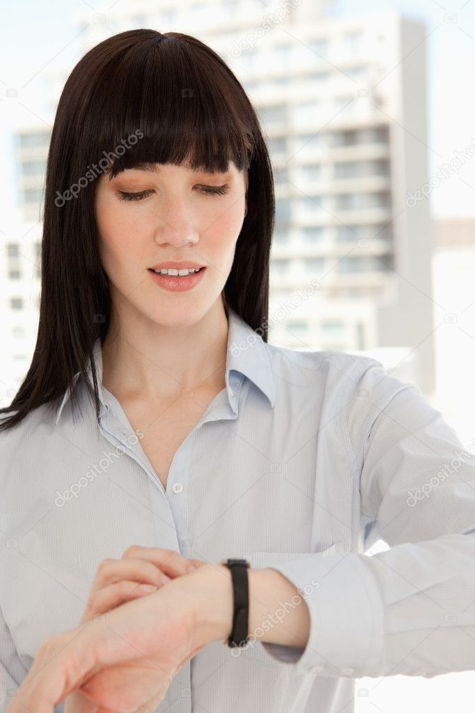 A close up shot of a woman looking at the time on her watch — Stock Photo #10331368