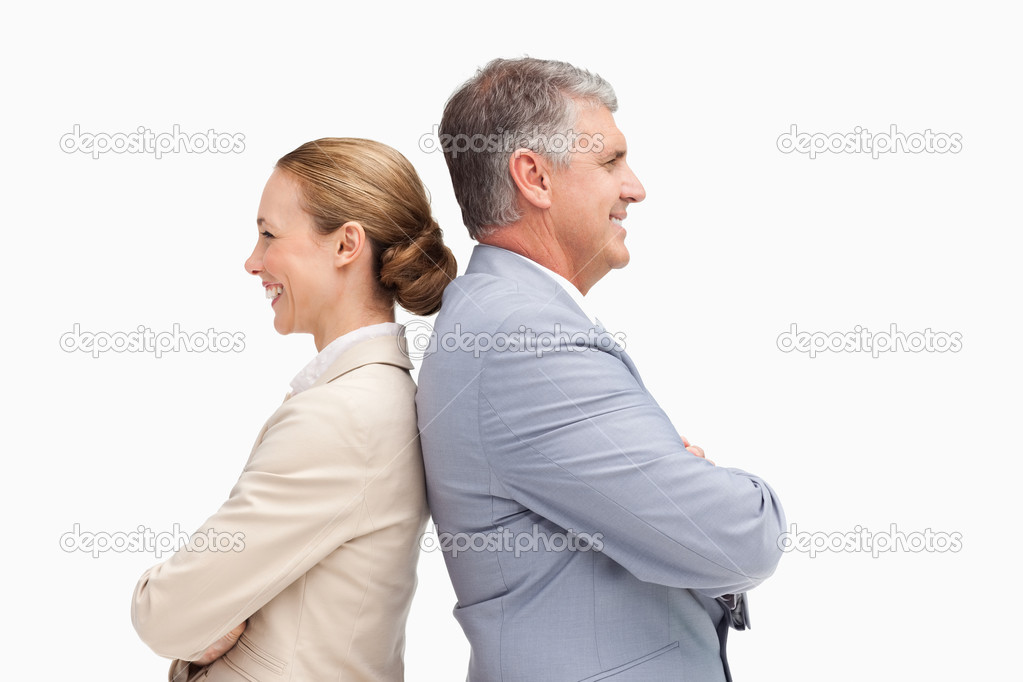 Business laughing back to back against white background  Stock Photo #10331807