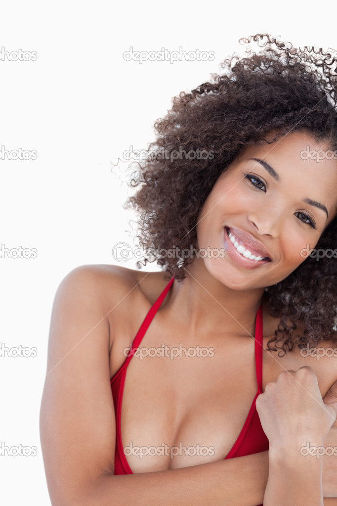 Smiling young brunette woman looking at the camera against a white background — Stock Photo #10334244