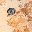 World map with compass showing Africa and Europe — Stok fotoğraf
