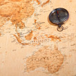 World map with compass showing Oceania - Stock Photo