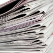 Newspapers on a white background — Stock Photo #10579555