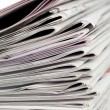 Newspapers on white background — Stock Photo #10579555