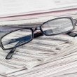 Royalty-Free Stock Photo: Newspapers and black glasses