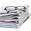Newspapers and black glasses — Stock Photo