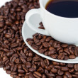 Cup of coffee and coffee beans — Stock Photo #10579836