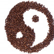 Brown and white symbol made of coffee beans — Stock Photo #10579976