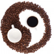 Brown and white symbol made of coffee beans — Stock fotografie #10579985