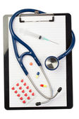 Note pad and stethoscope with color capsules and blister strip — Stock Photo