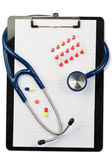 Note pad and stethoscope with color pills and blister strip — Stock Photo