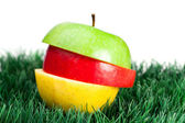 Combination of green, yellow and red apples on grass — Stock Photo
