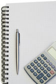 Notebook with pencil and pocket calculator — Stock Photo