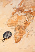 World map with compass showing Africa — Stock Photo