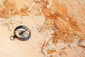 World map with compass showing Africa and Asia — Stock Photo