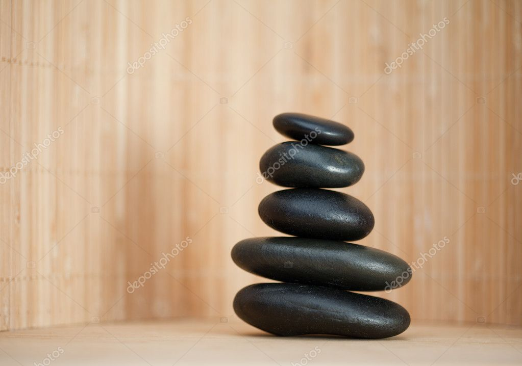 Several piled up pebbles on a brown background — Stock Photo #10577302