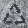Recycle symbol on a white chalky background - Stock Photo