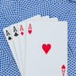 Stock Photo: Games card aces on a cards background