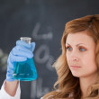 Cute female scientist conducting an experiment — Stock Photo
