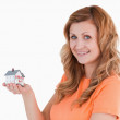 Cute woman holding an house model — Stock Photo