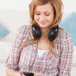 Blonde woman with headphones and mp3 player — Stock Photo #10587339