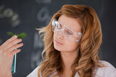 Attractive female scientist conducting an experiment — Stock Photo