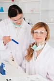 Female scientists with safety glasses — Stockfoto