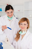 Female scientists with safety glasses looking at the camera — Stock Photo