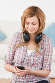 Blonde woman with headphones and mp3 player — Stock Photo