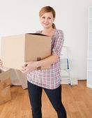 Cute woman carrying cardboard boxes — Stock Photo