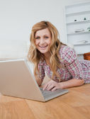Blonde woman chatting on her laptop — Stock Photo