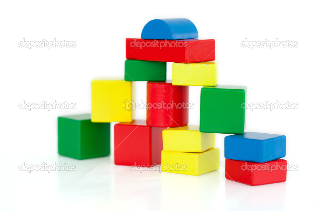 Wooden building blocks on a white background — Stock Photo #10581587