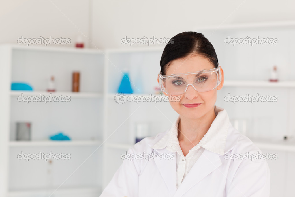 Dark-haired woman posing in a lab — Stock Photo #10583632