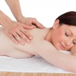 Closeup of a charming red-haired woman receiving a massage in a — Stock Photo #10594464